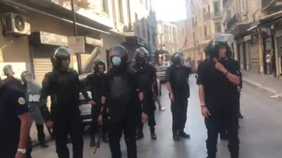 Police and protesters clash in Bourguiba Street, Tunis, June 12, 2021